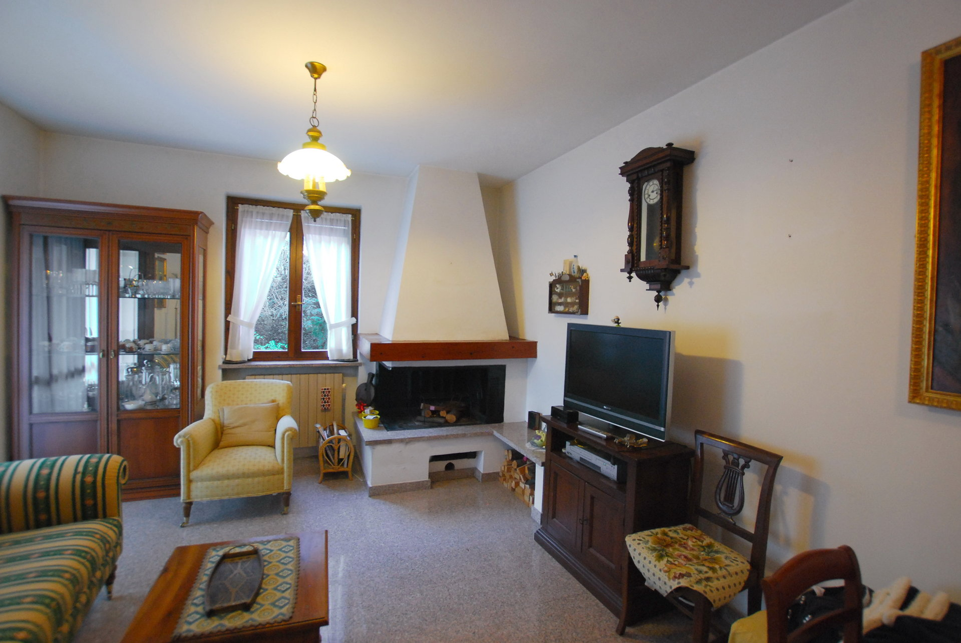 two-room for sale in Stresa- living room with fireplace