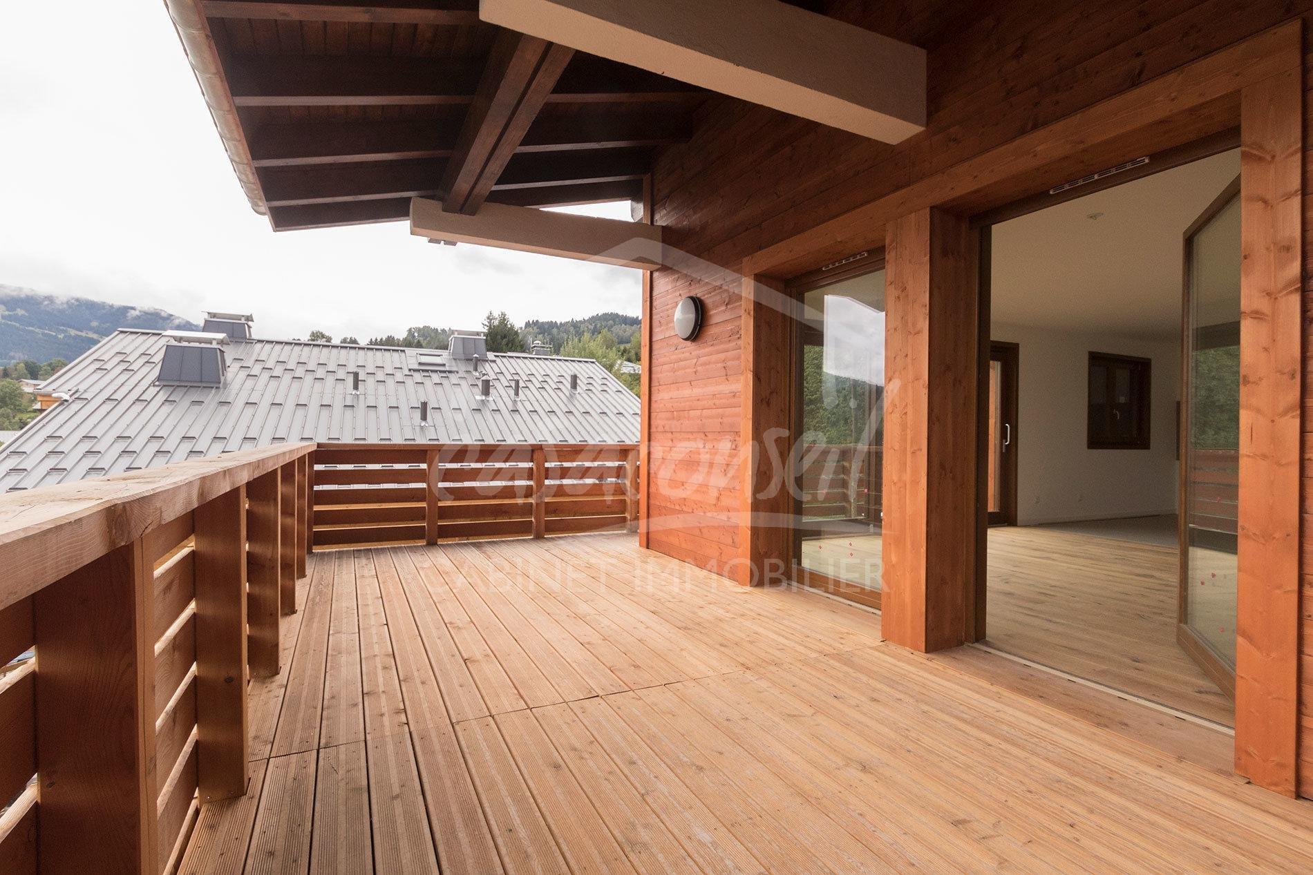 Combloux- Chalet divisé en 2 appartements duplex