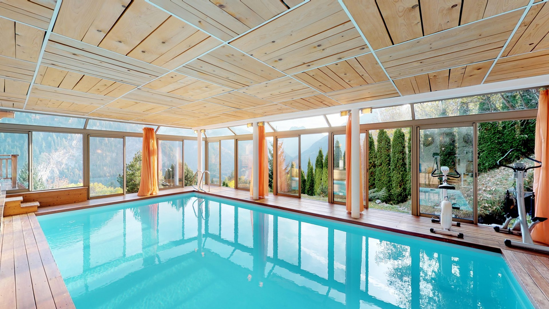 Large indoor pool with a magnificent view
