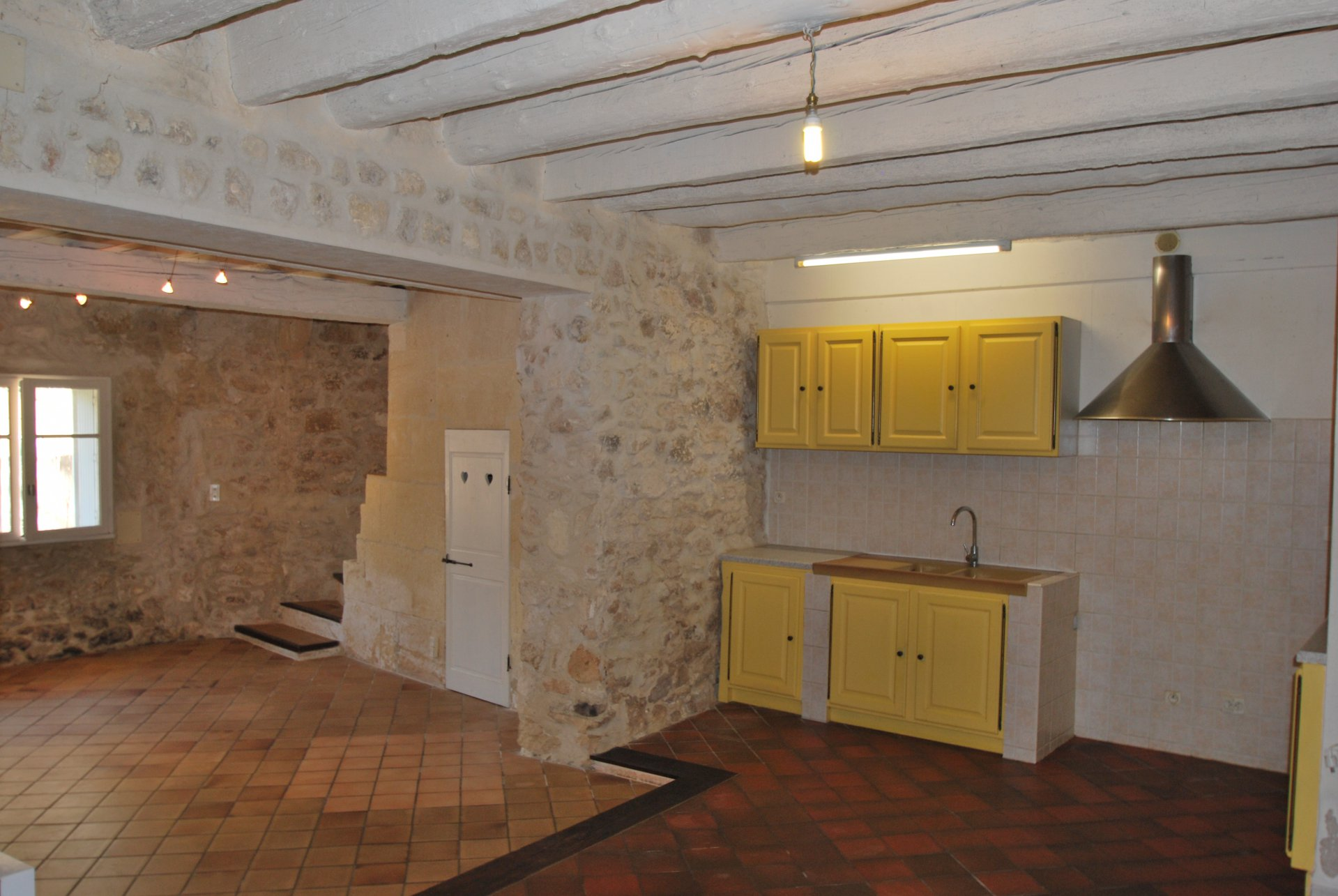 Kitchen, stainless steel, natural light, tile
