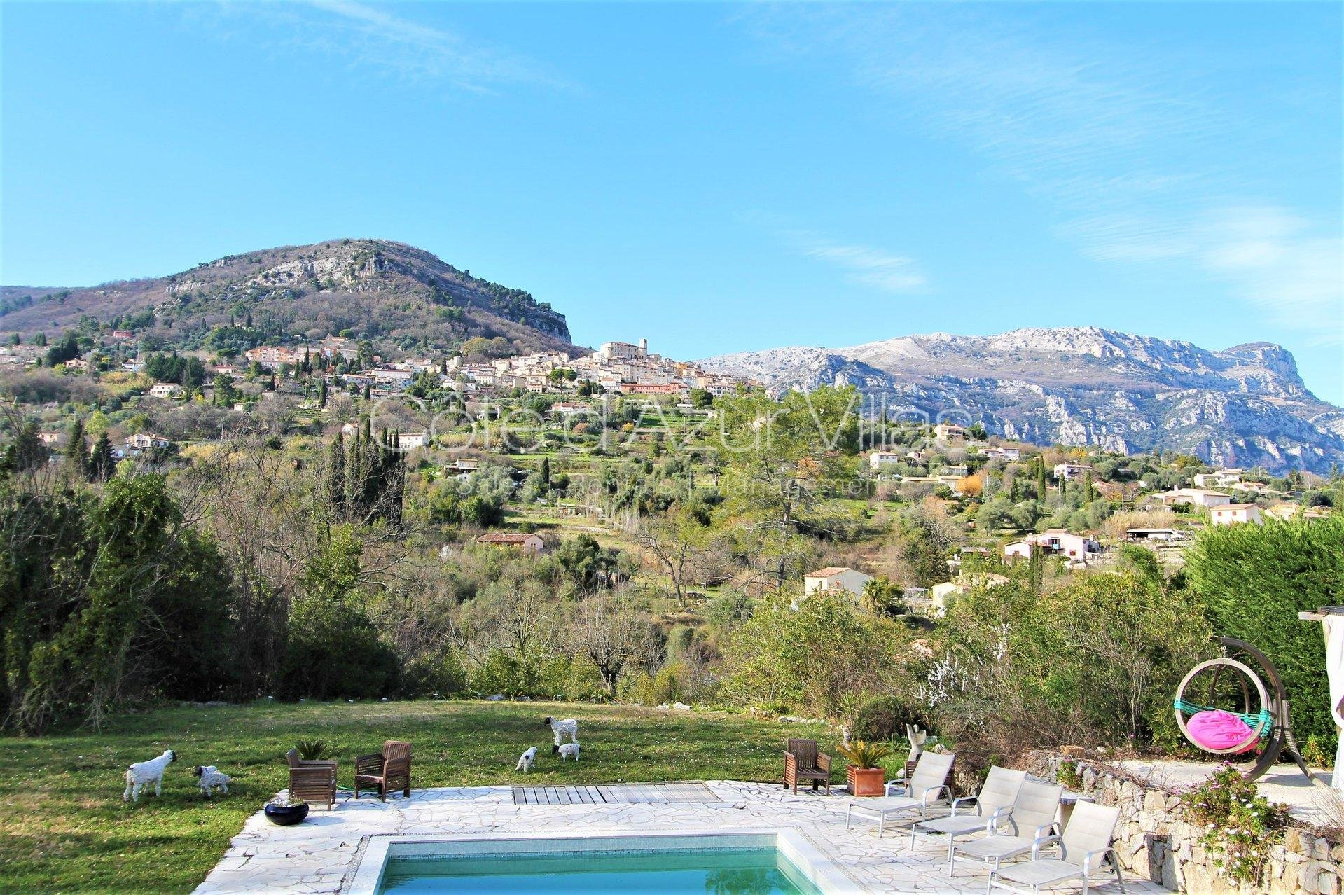 5-bedroom villa with panoramic views over hills and village