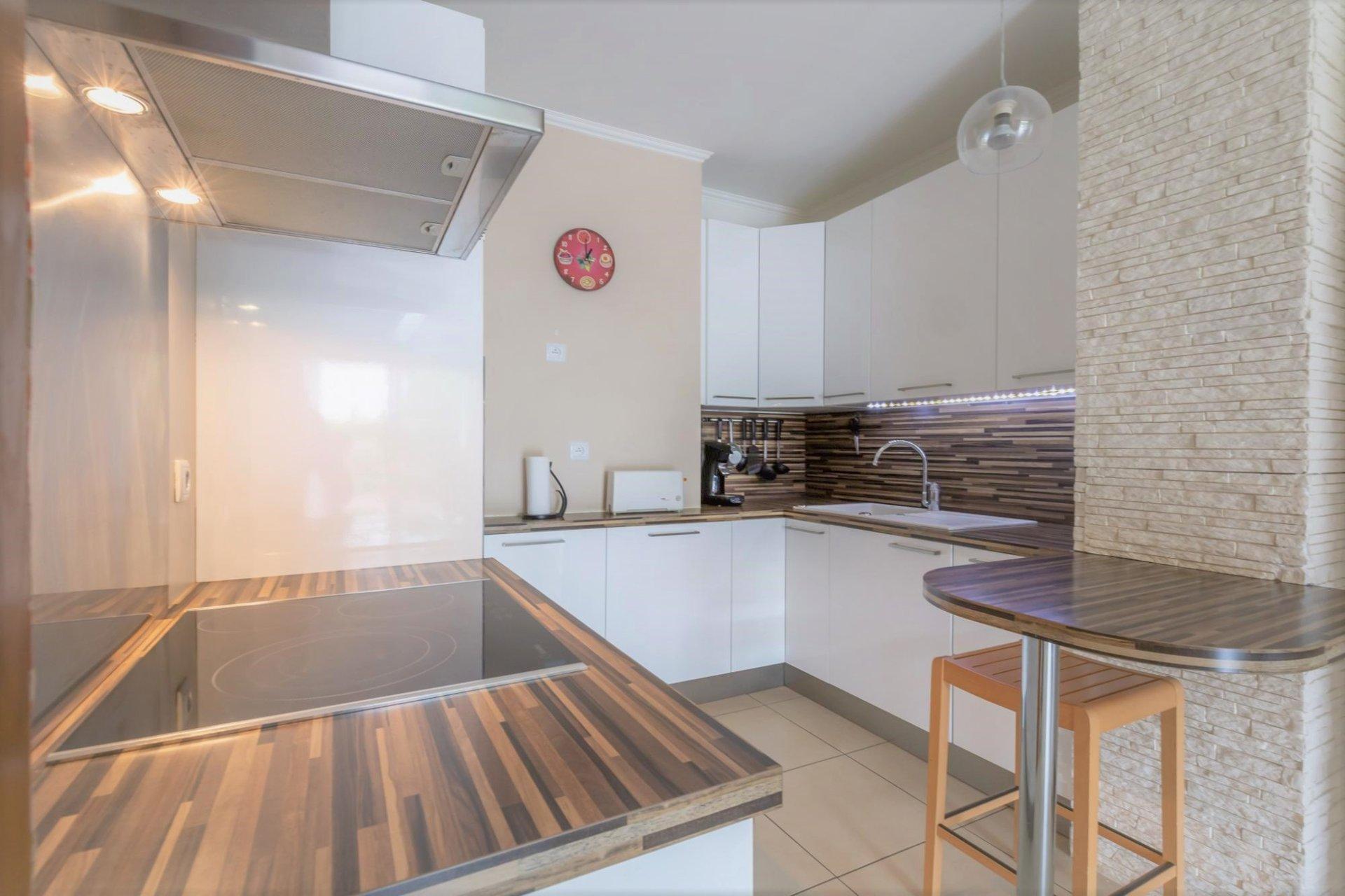 Appartement 2 pièces 52 m² avec terrasse et jardin privatif d'environ130 m²