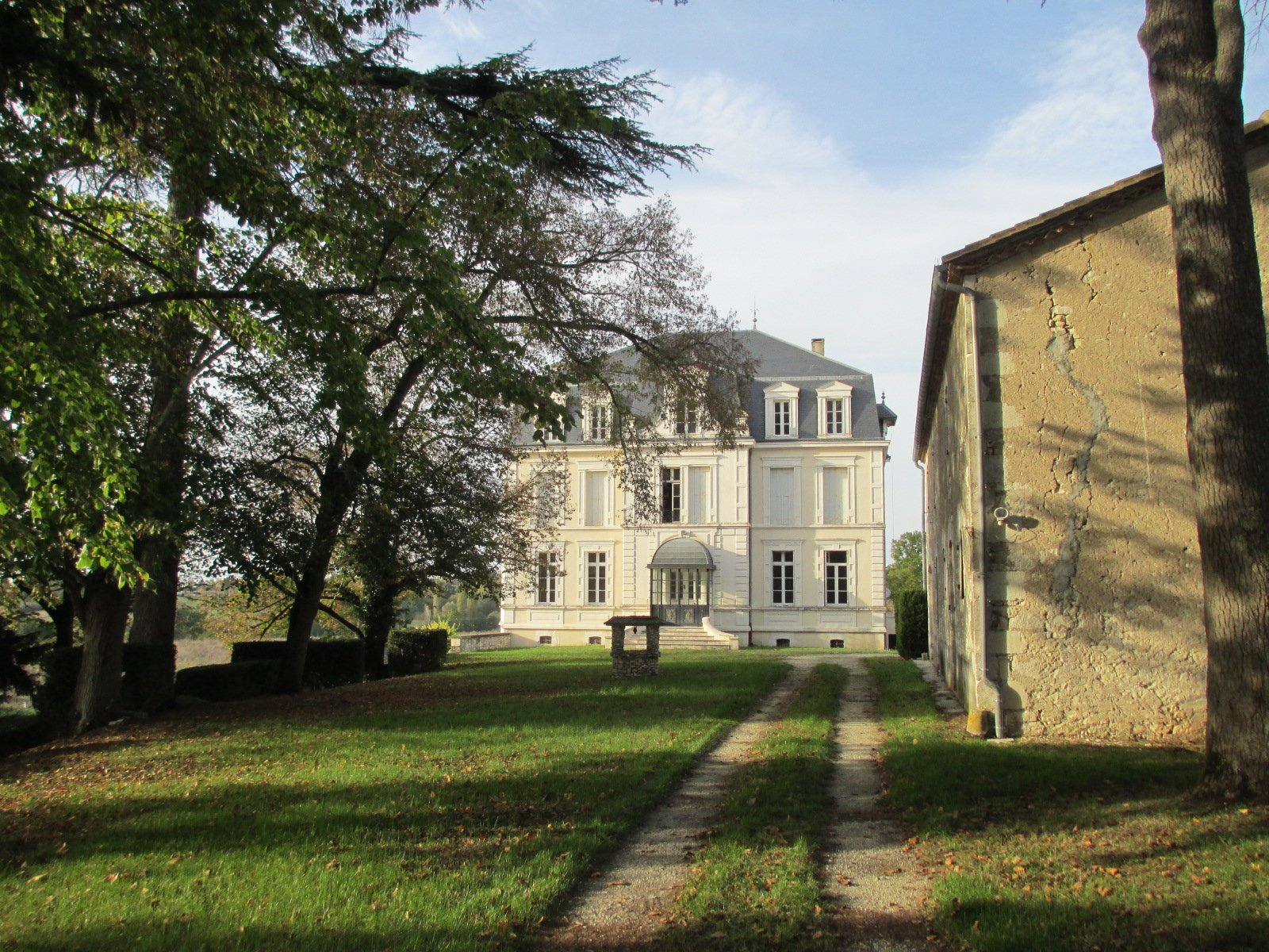 Château with pool, and outbuildings near village