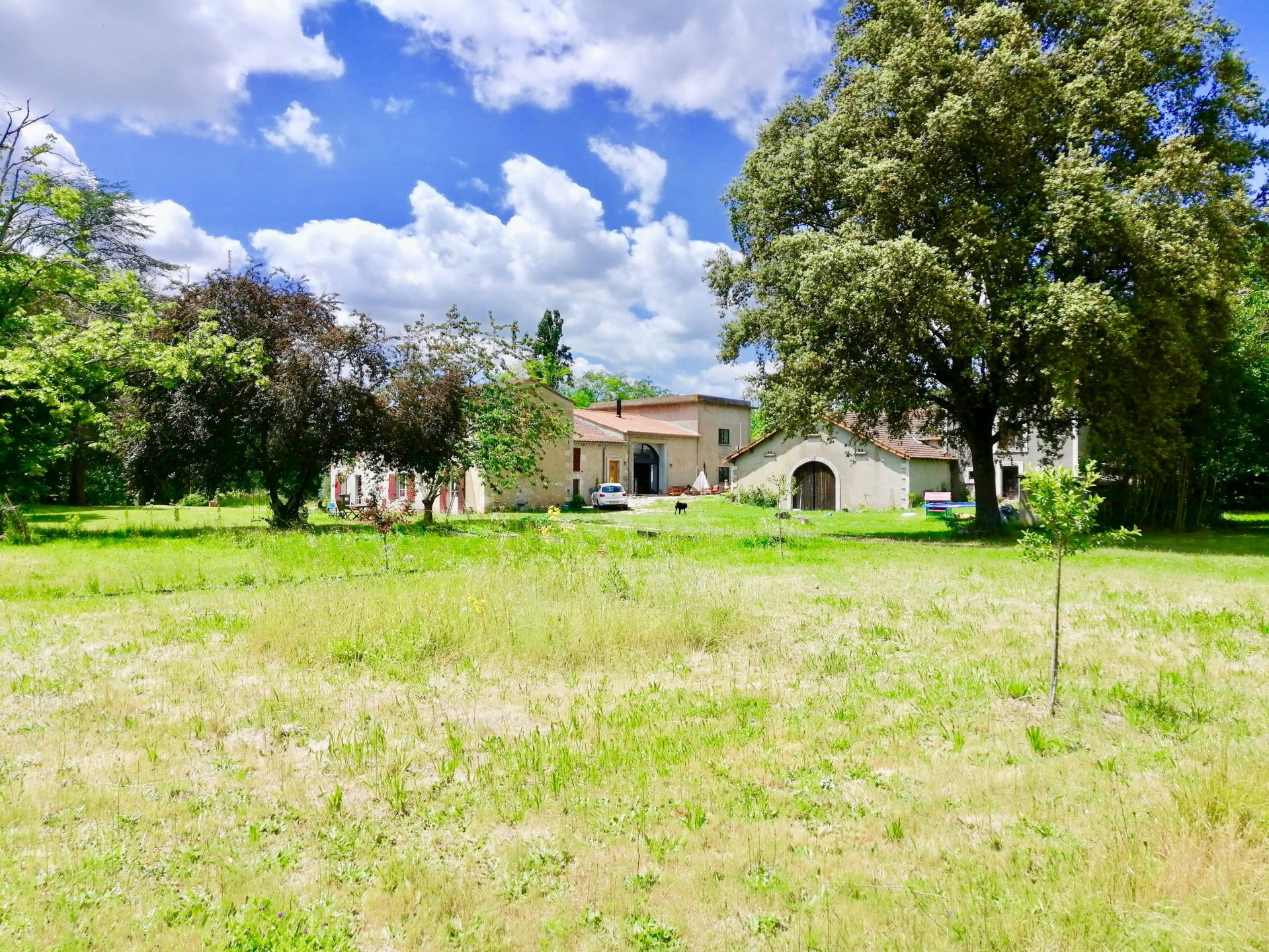 Modernised riverside property with 2 Gites to develop.