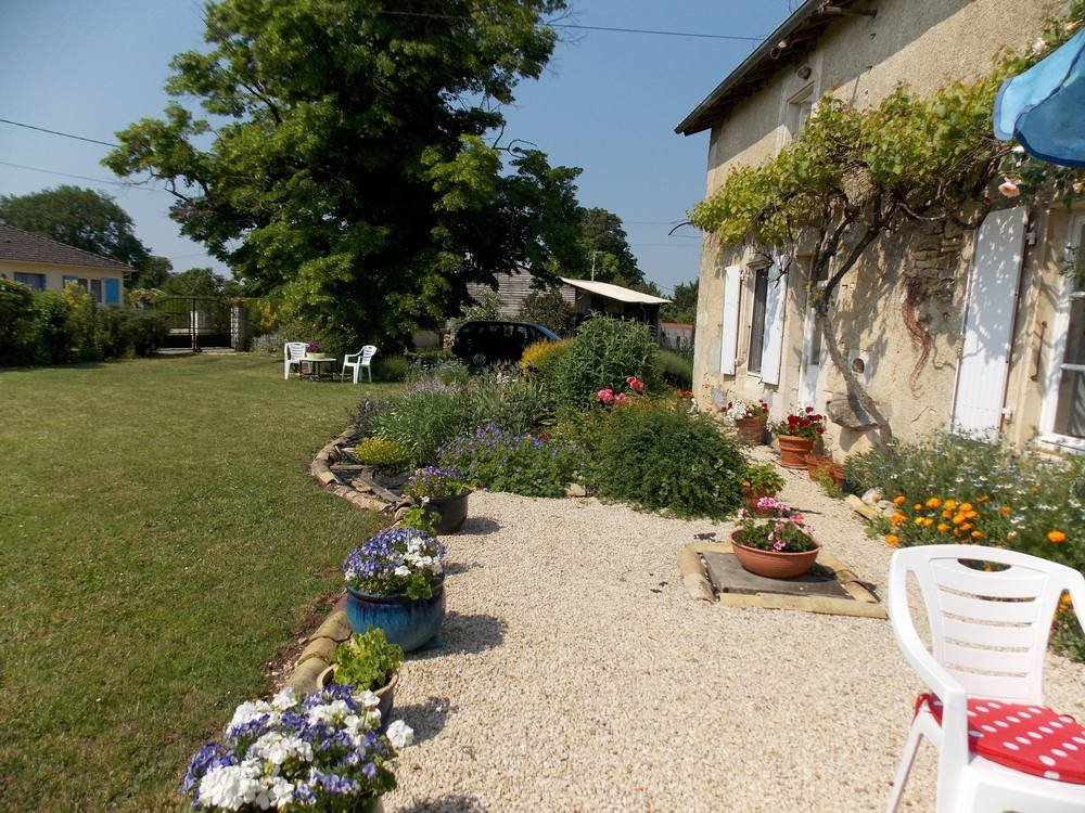 Detached stone house, outbuildings and pretty garden in a quiet hamlet