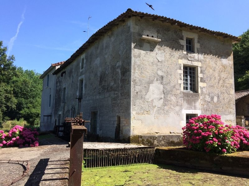Incredible water mill with all the original working. Prepare to be charmed!