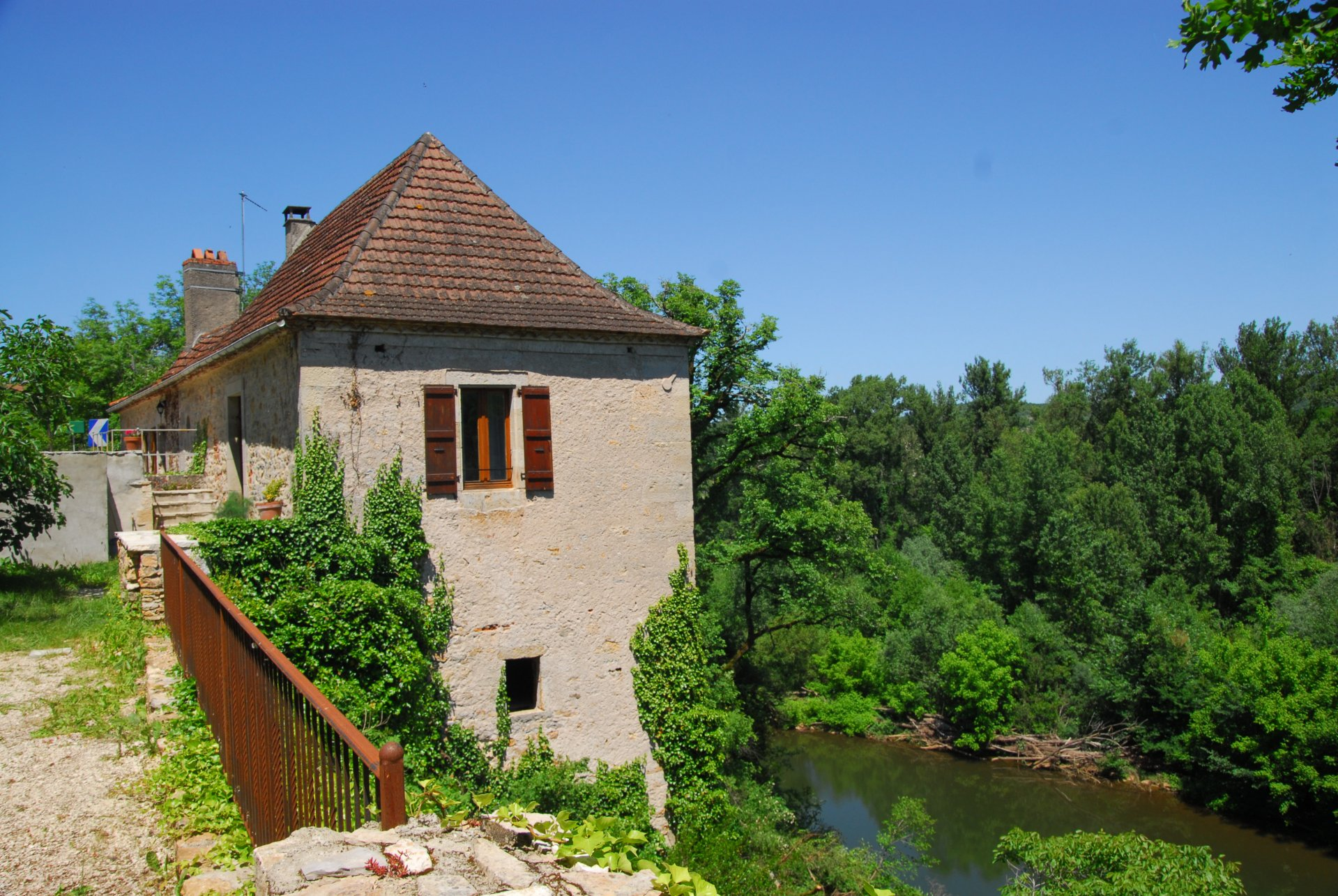 Beautiful stone house on the riverbank of river Lot