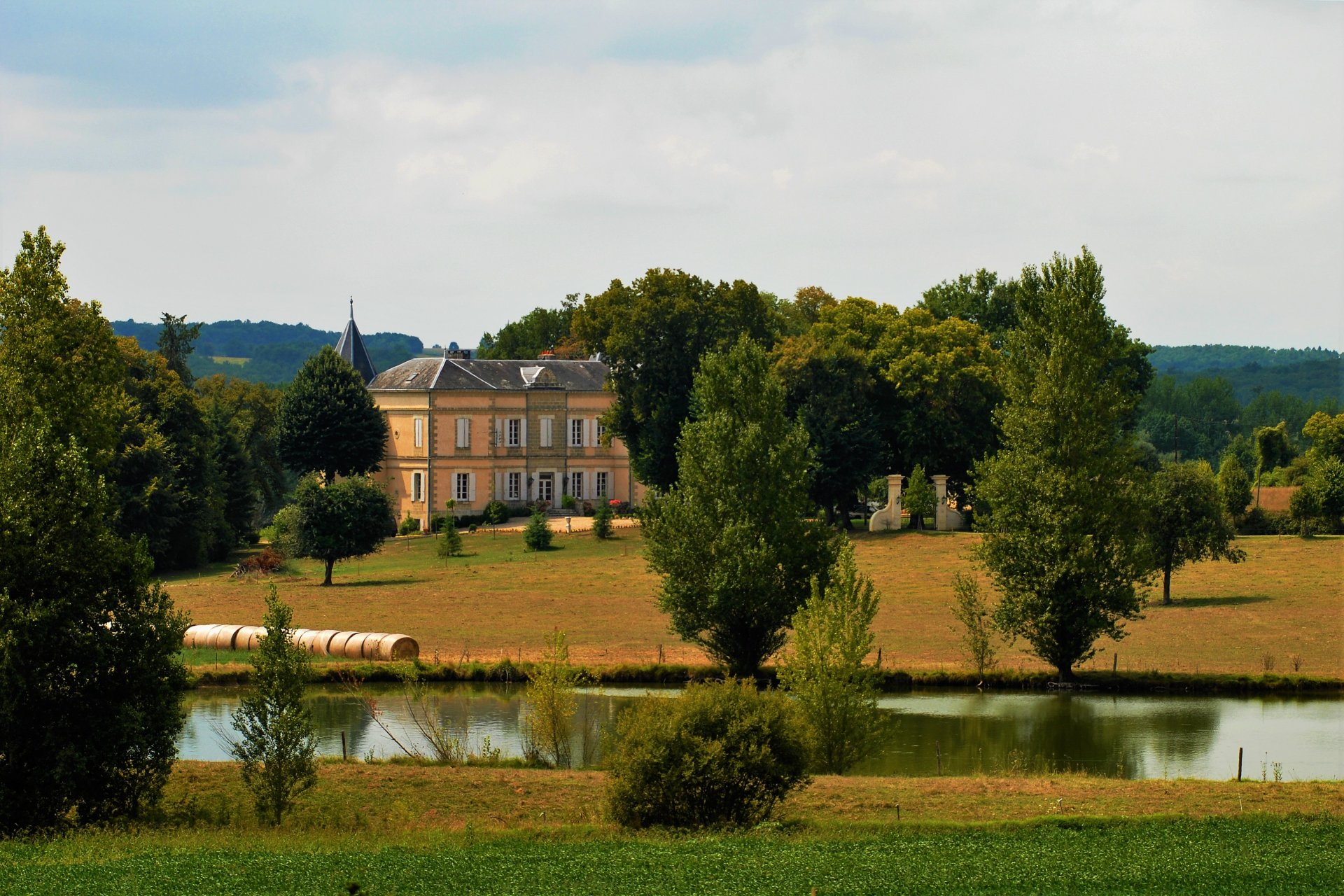 Beautiful 18th century castle in a beautiful park with trees and a pond