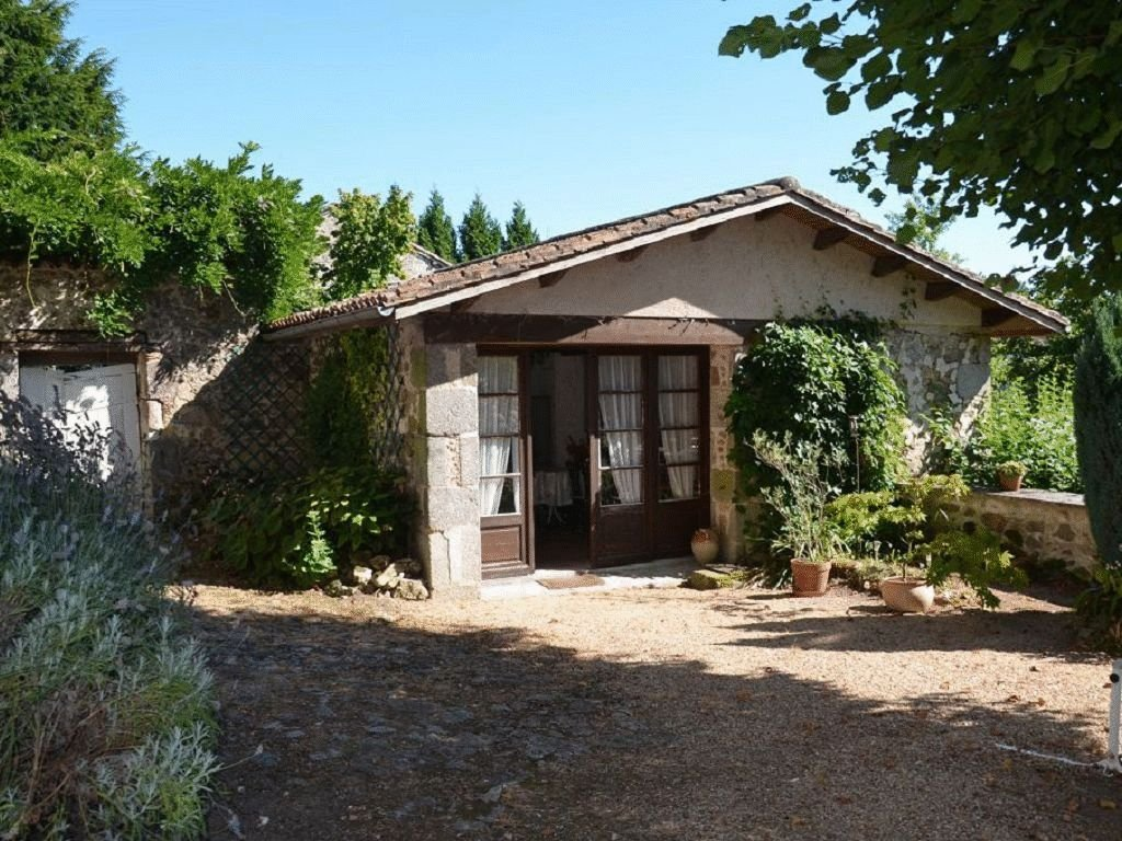 Stylish stone house in centre of village with garage, barn and stables.