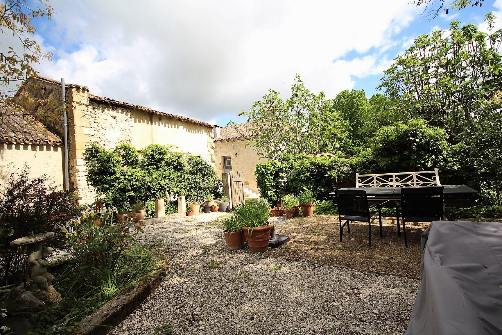 Two bedroom stone house in the heart of a Bastide Town, with barn, walled garden and stone workshop