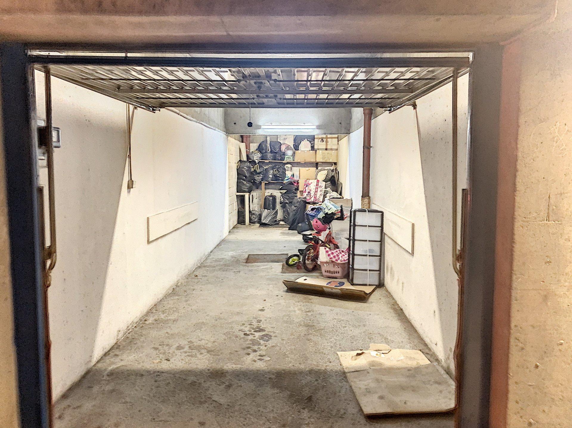 CENTRE 2 F3 AVEC BALCON CAVE ET GARAGE DOUBLE