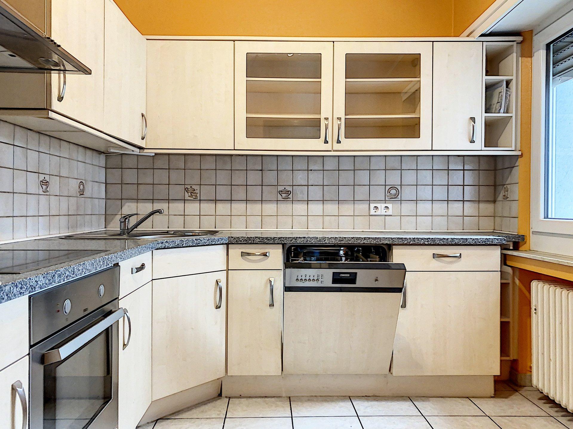 Differdange - Fousbann Appartement avec deux chambres, double cave, emplacement extérieur et garage box fermé