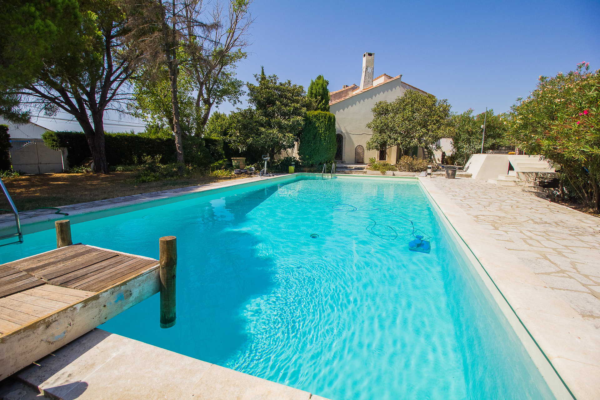Large house with pool and mature gardens on the edge of the village
