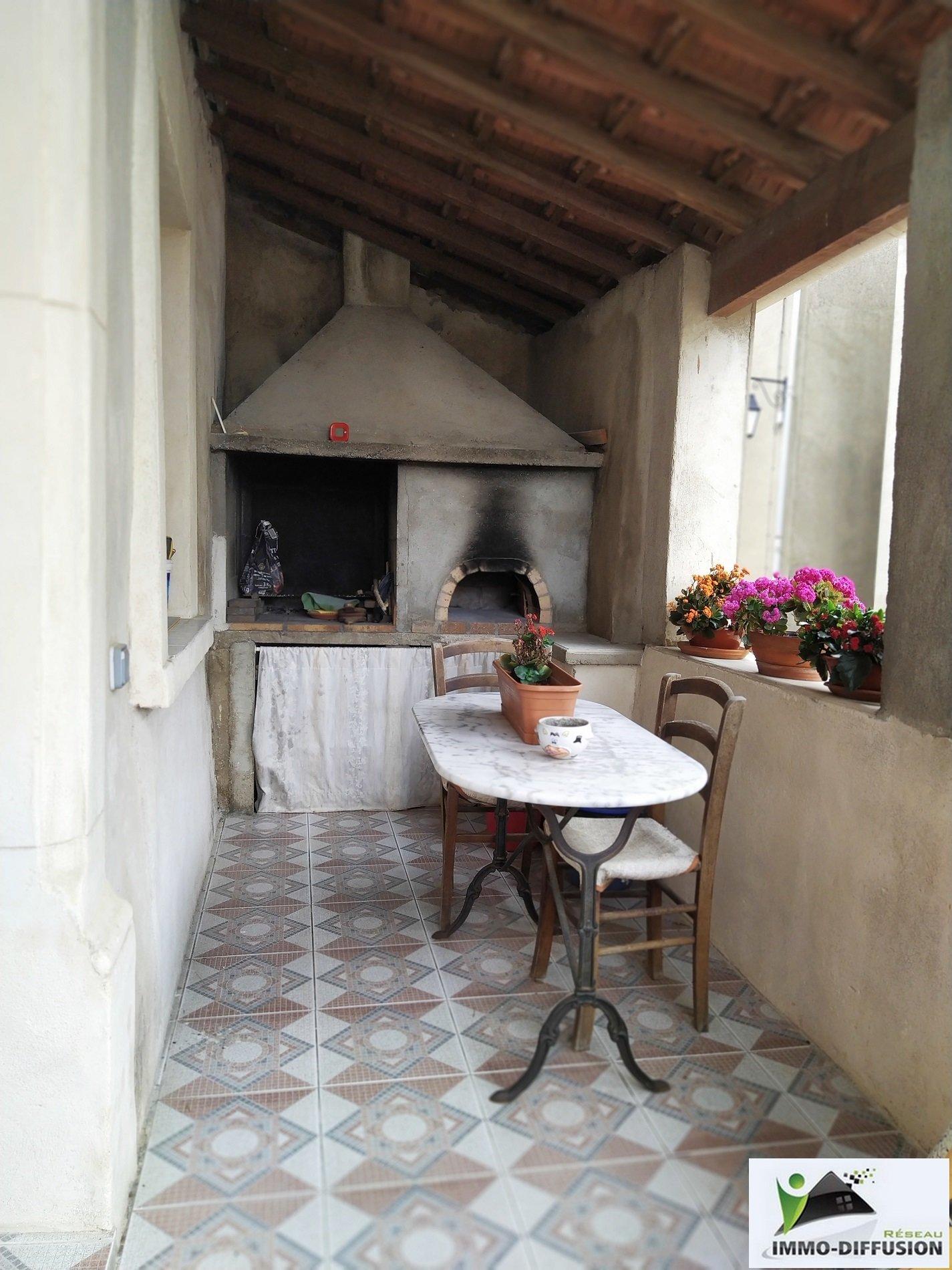 Village house with a garage