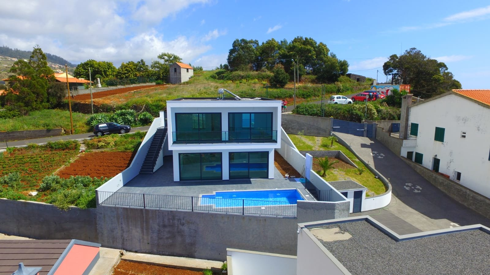 Modern villa with pool and panoramic ocean views.