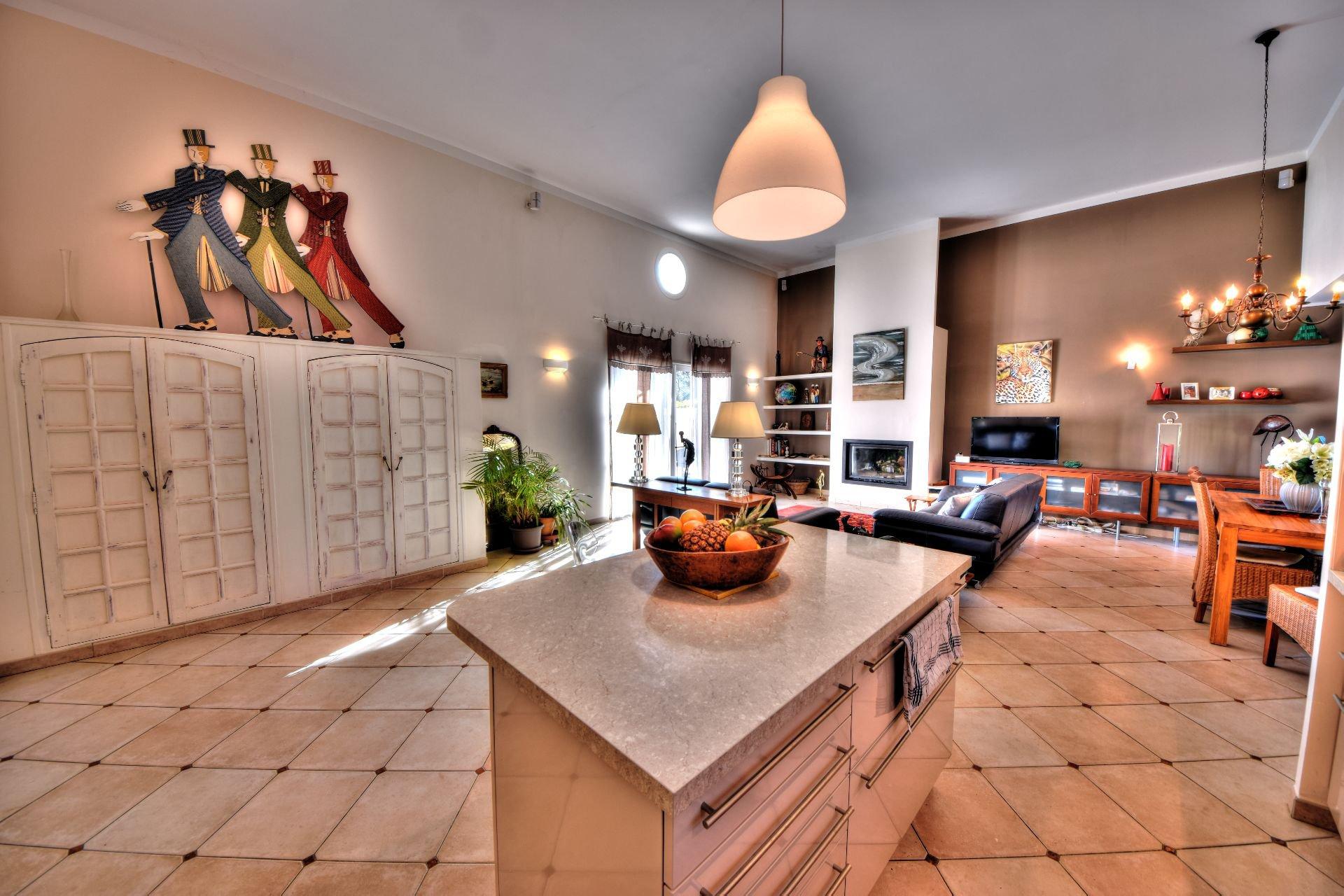 Chandelier, natural light, kitchen bar, kitchen island