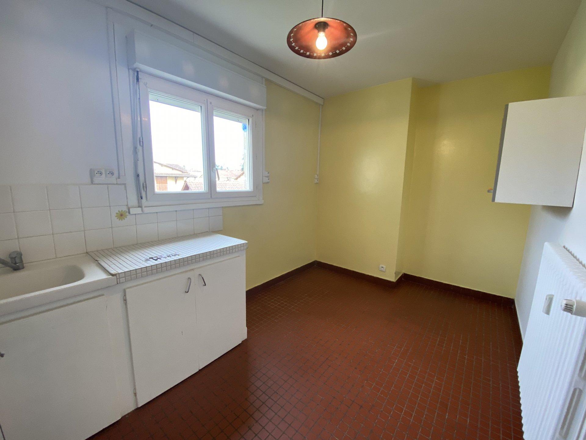 Appartement T3 avec balcon, parking et cave