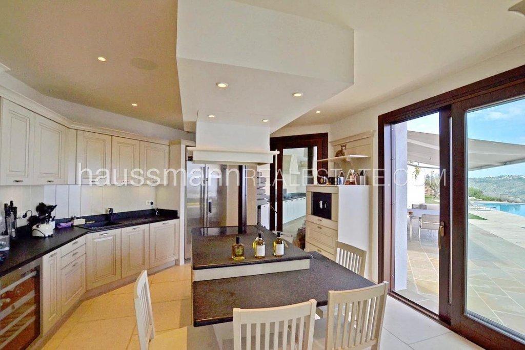 Natural light, stainless steel, kitchen bar, kitchen island