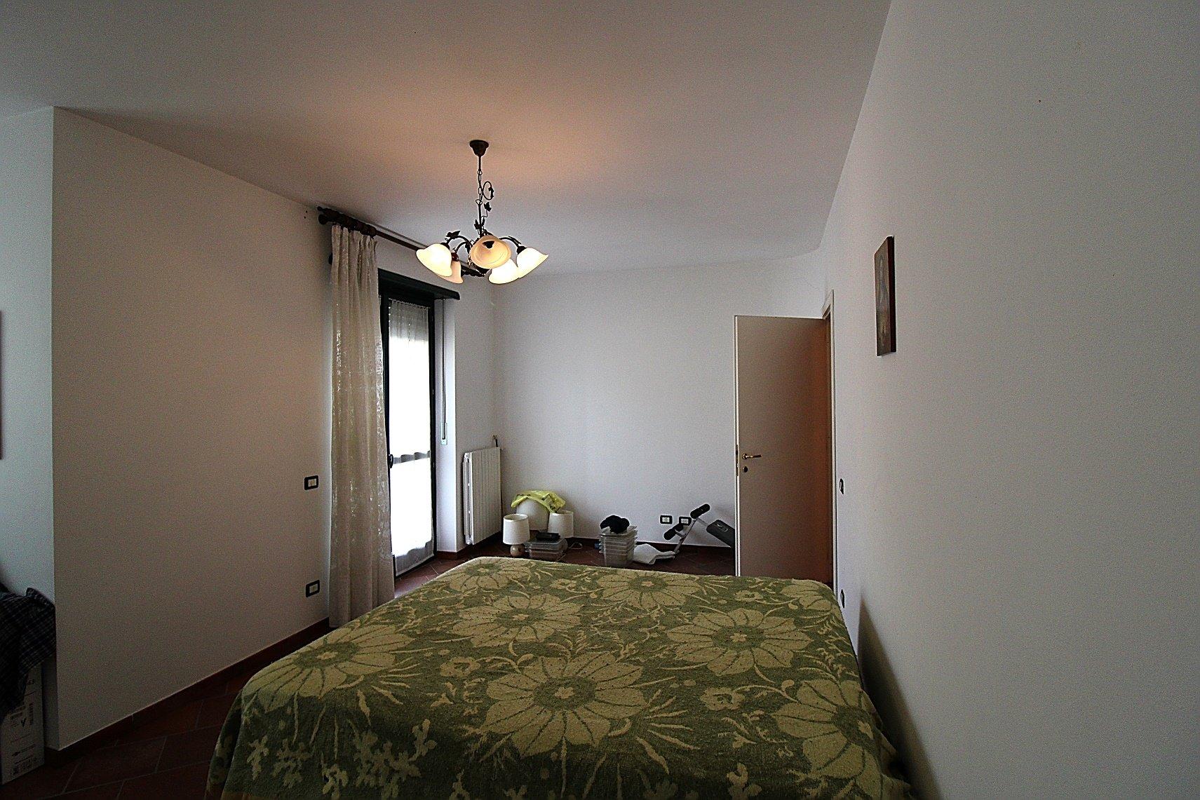 Priocca, due alloggi residenziali e laboratorio artigianale