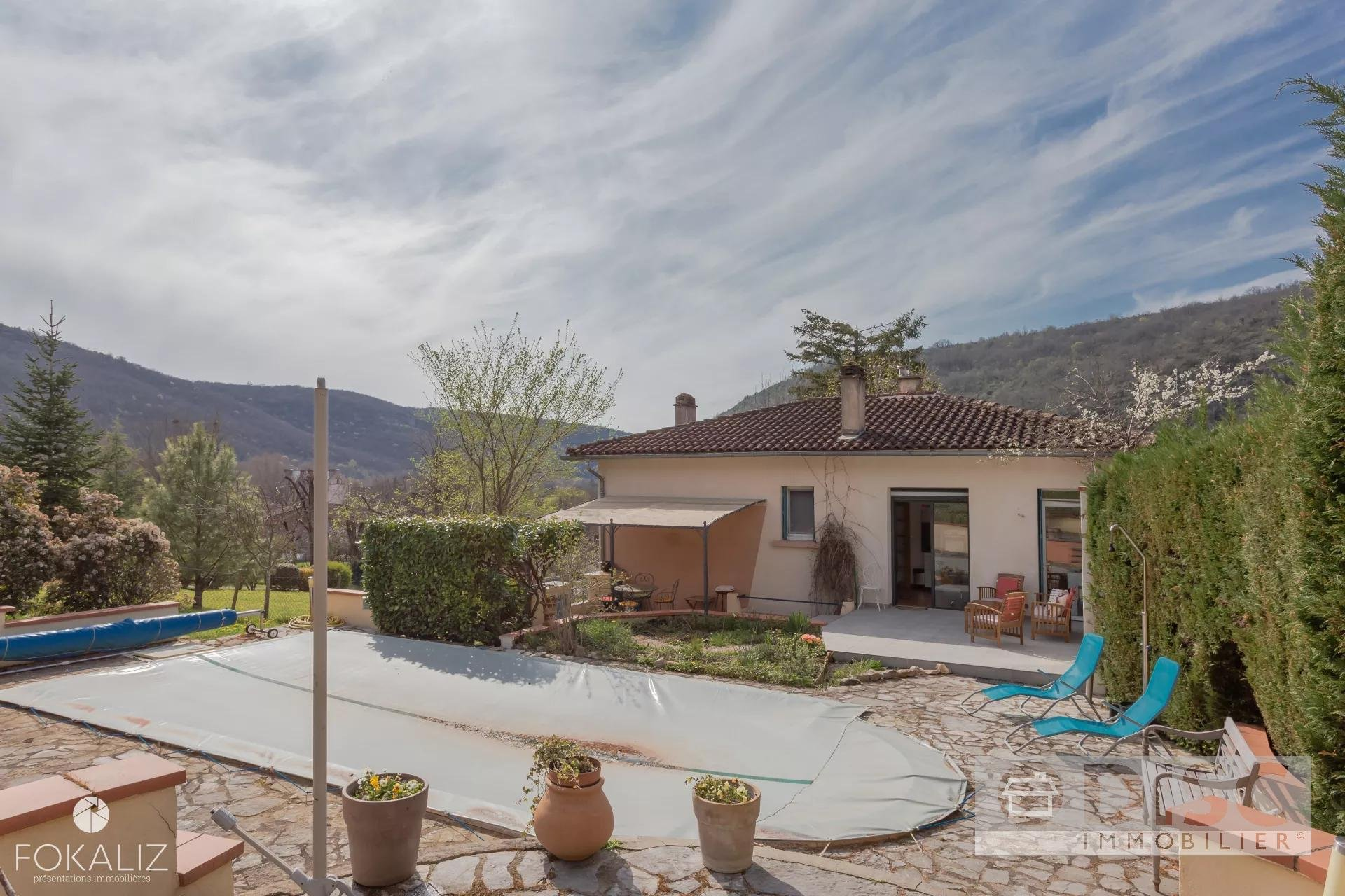 Village house with swimming pool and large garden.