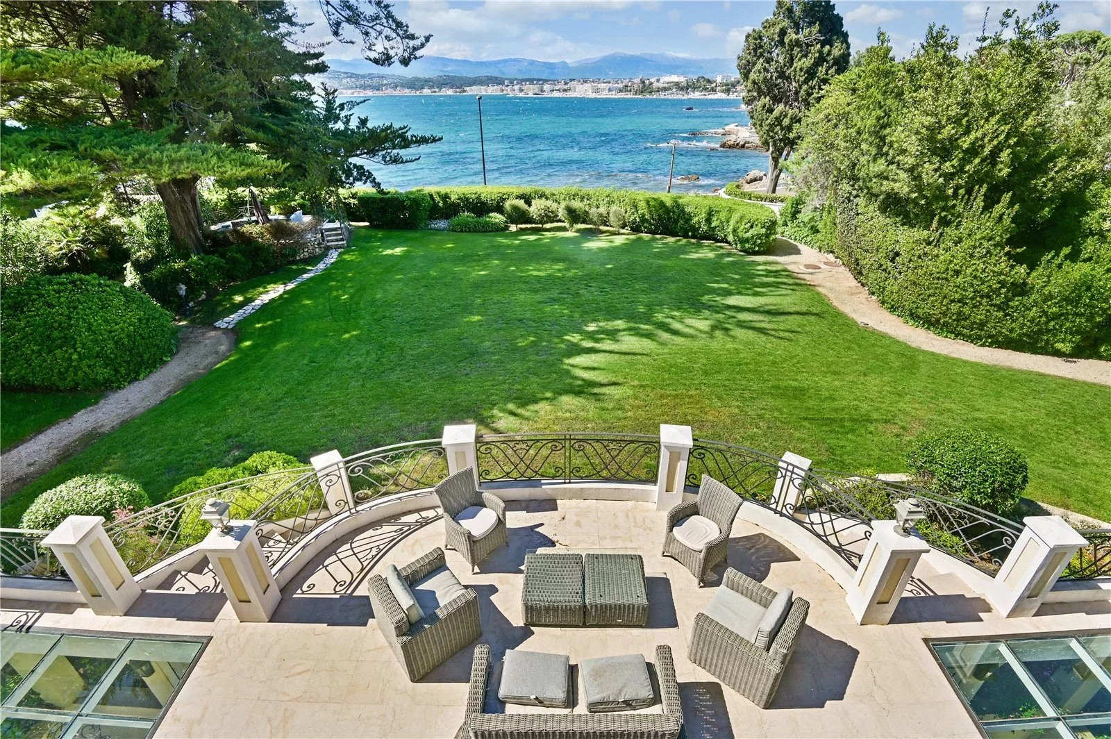 Outstanding waterfront property, set in landscaped grounds with heated pool, pool house, tennis cour
