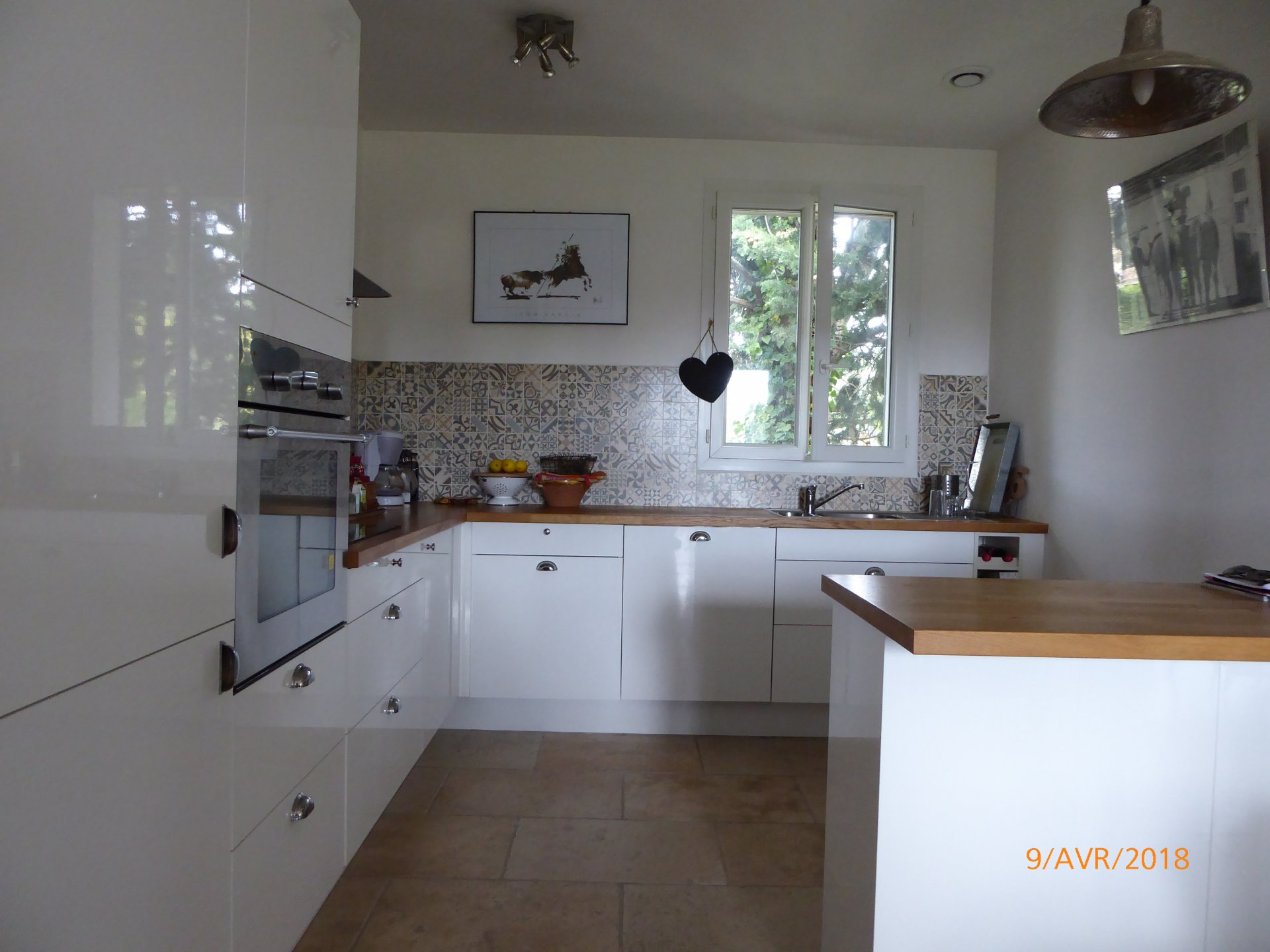 Kitchen, natural light, stainless steel, tile