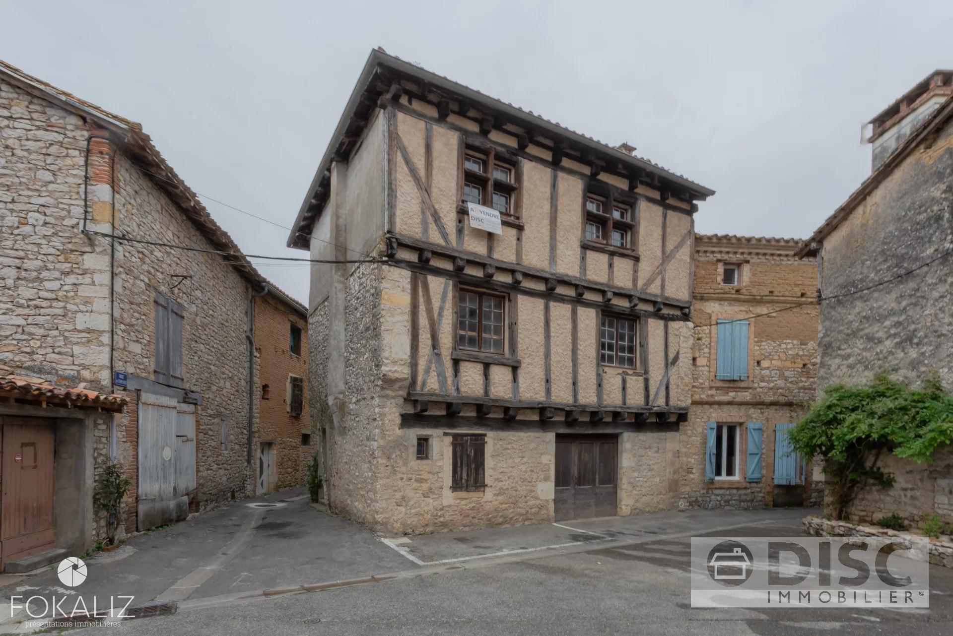 Village house with garage on village square.