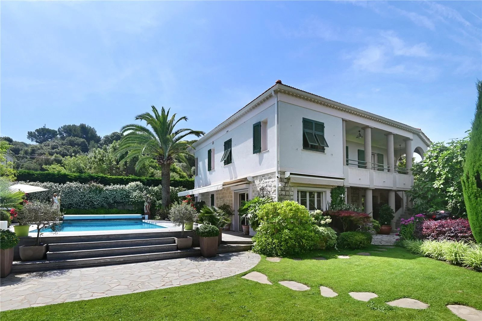 Ideally located for the beaches, charming five bedroom villa with separate studio, pool, Jacuzzi an