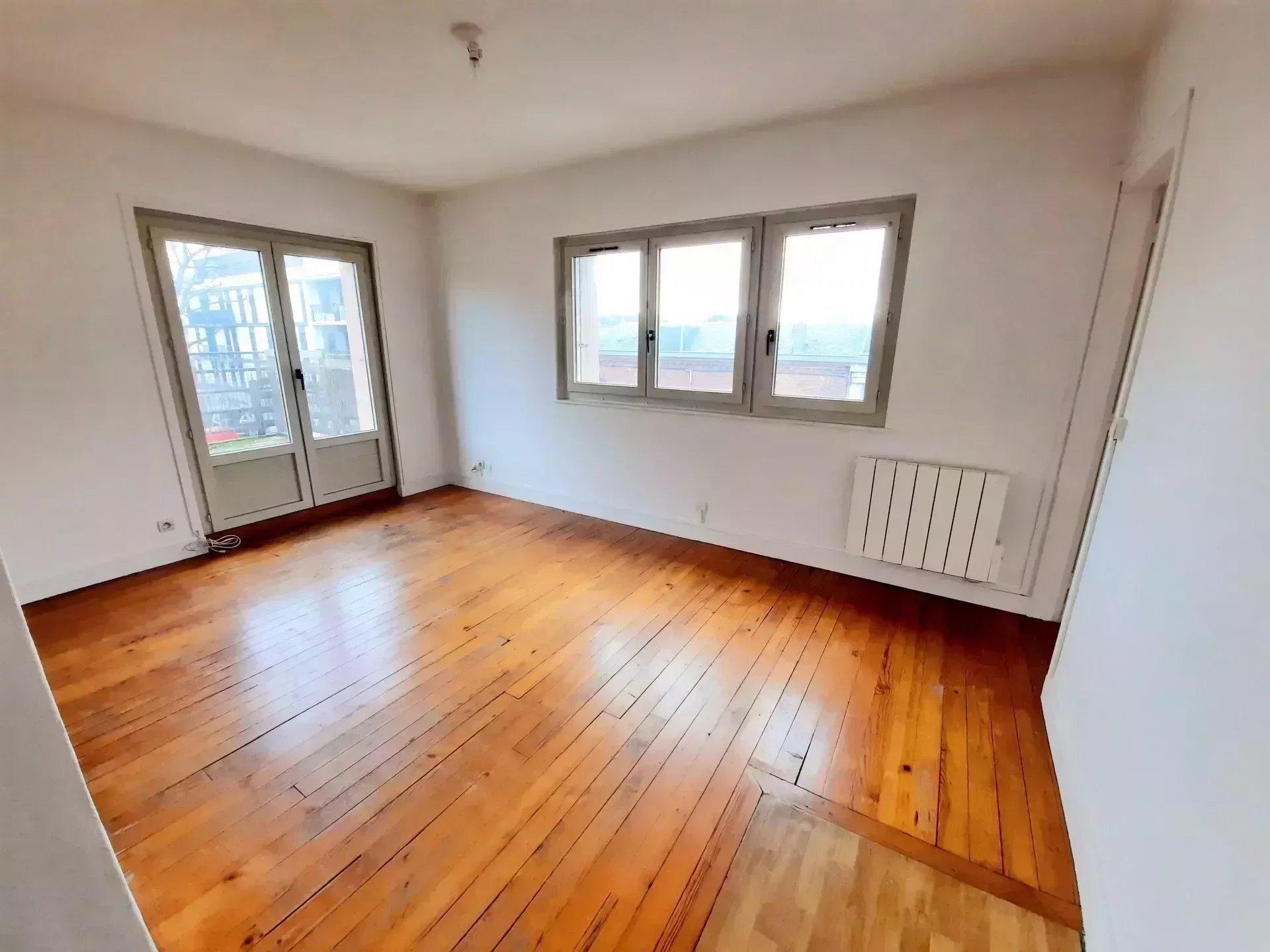 Appartement 3 pièces 56 m² avec terrasse et grenier à aménager