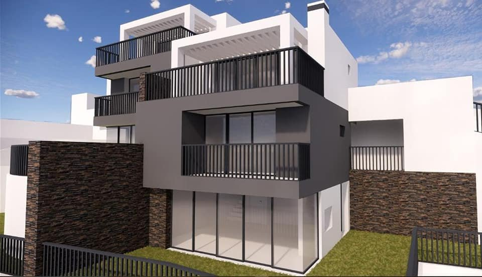 Semi-detached house under construction with garden