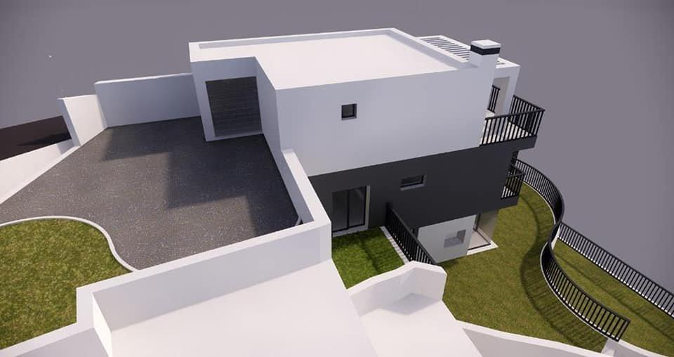 Maison mitoyenne en cours de construction avec jardin.