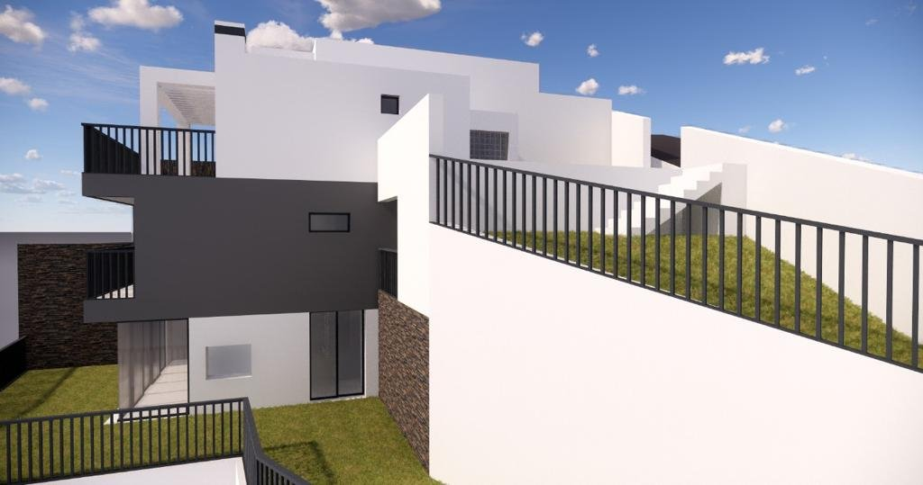 Semi-detached house under construction with garden.