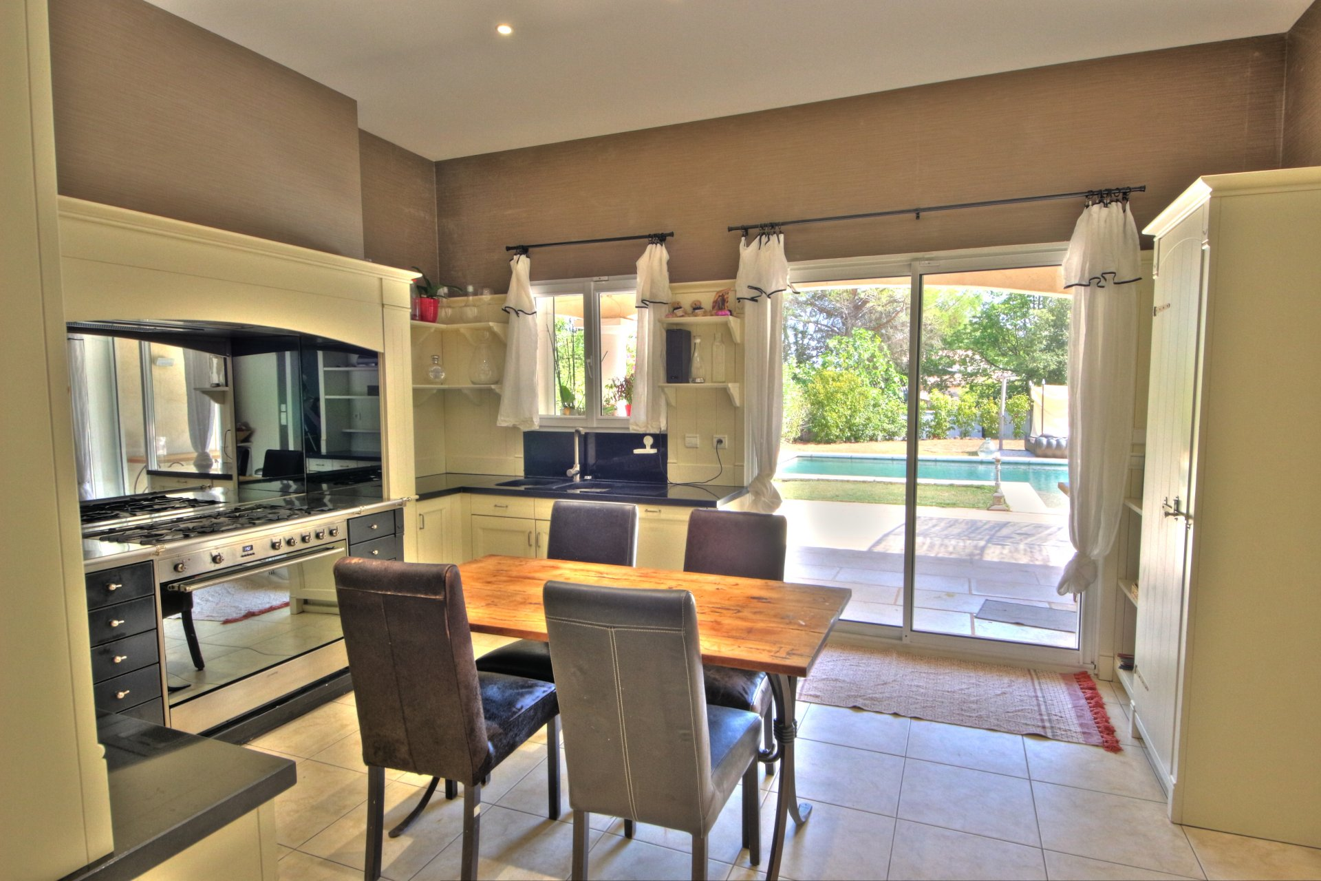 Bright and spacious kitchen, with plenty of storage, quality materials, access to the terrace
