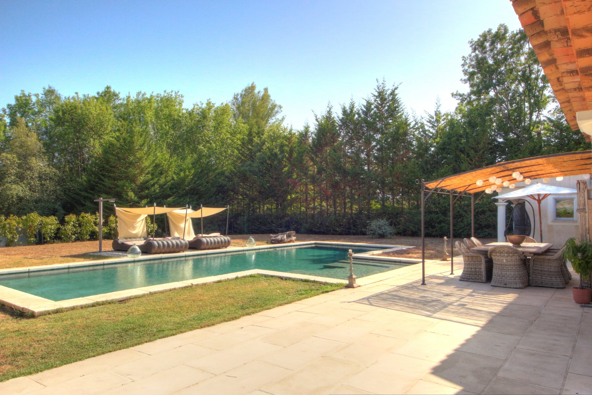 Large garden and terrace with a traditional 15x5 mosaic swimming pool