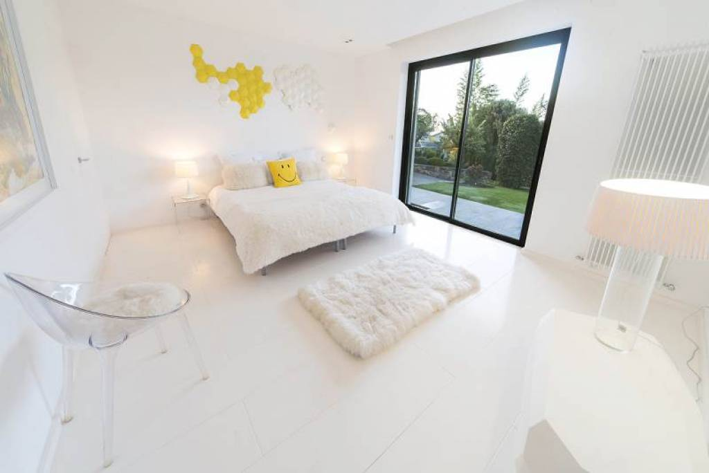 white bedroom with smiling pillow