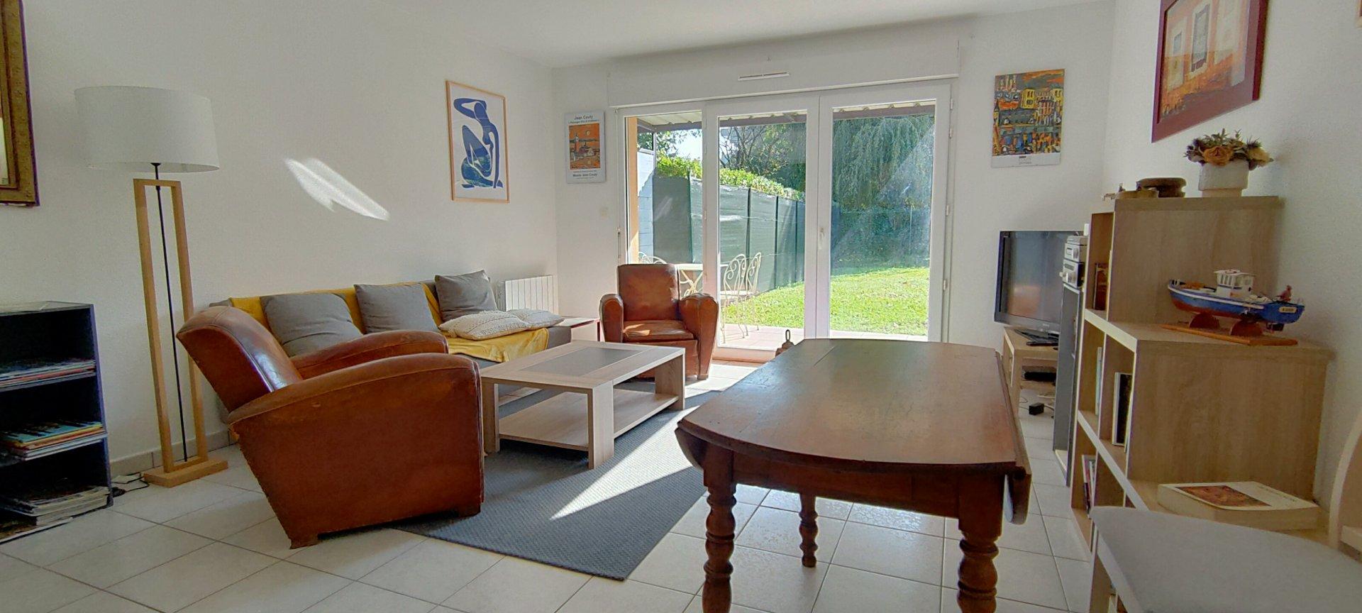 Appartement 2 CH avec jardin privatif et garage