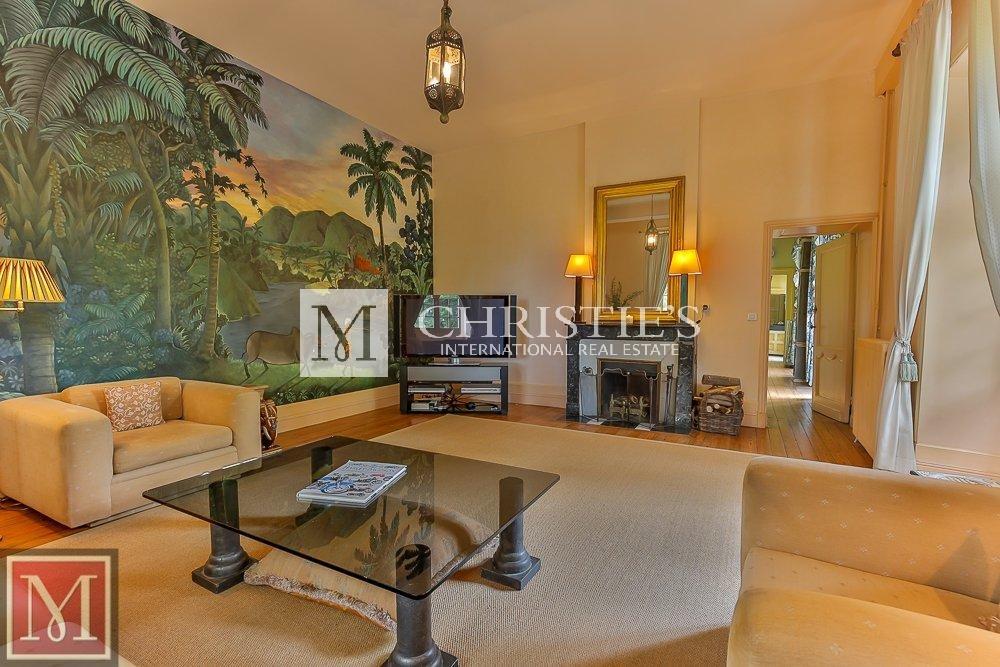 Living room, fireplace, art wall