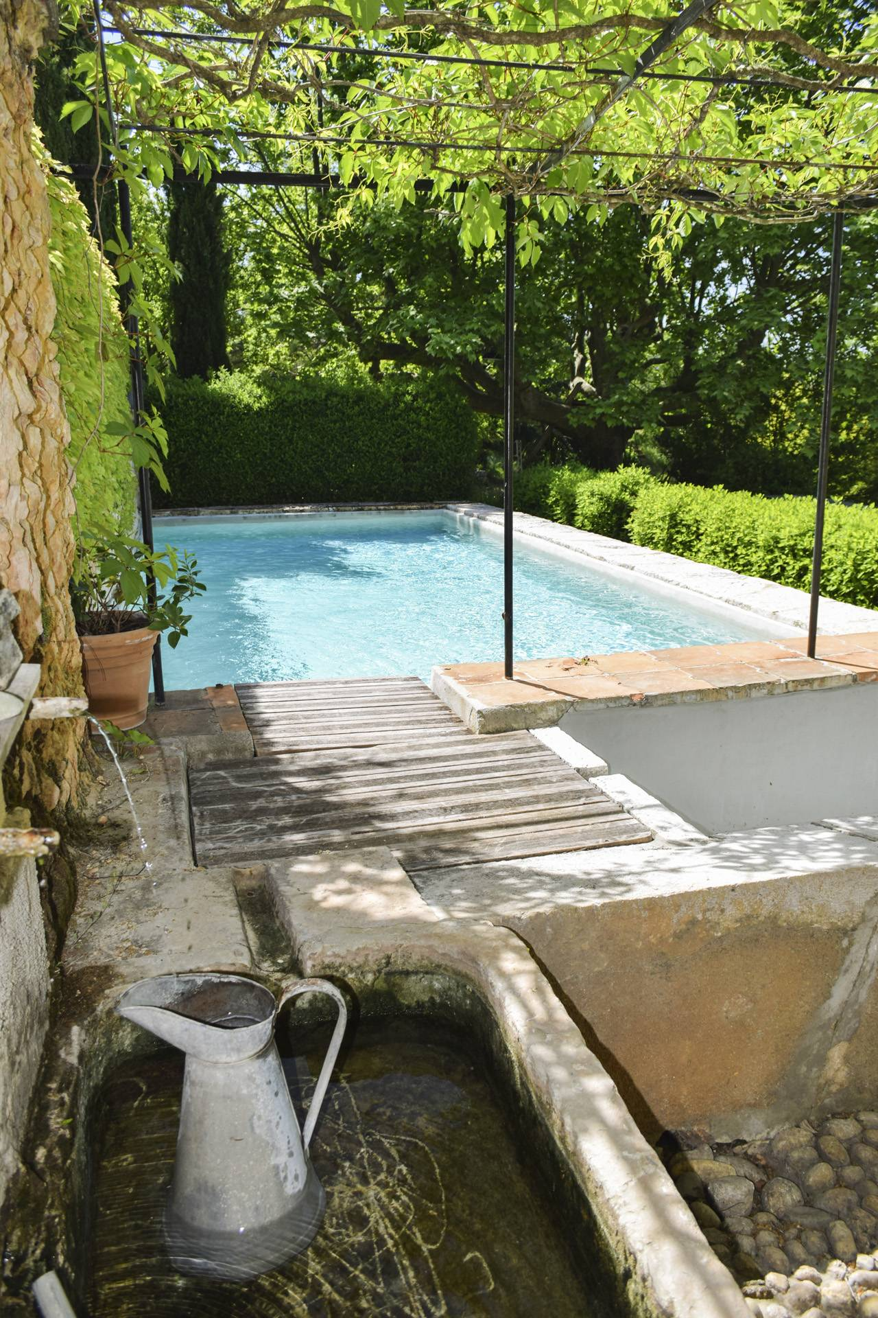 view swimming pool from fontain  renovated country house on 8 ha, swimming pool, caretaker's house, aups var, provence