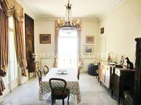Dining room, chandelier, natural light, carpet