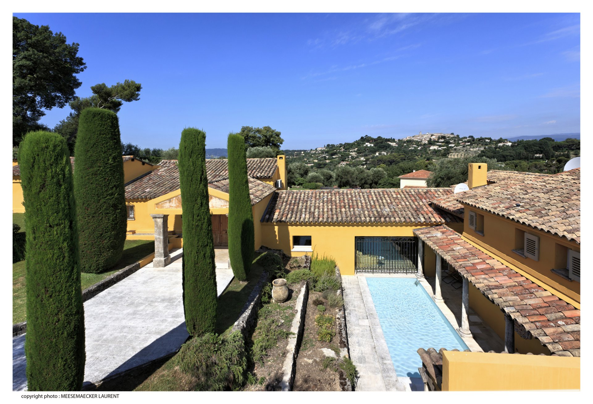 Property with pool and tennis court in gated Domaine.