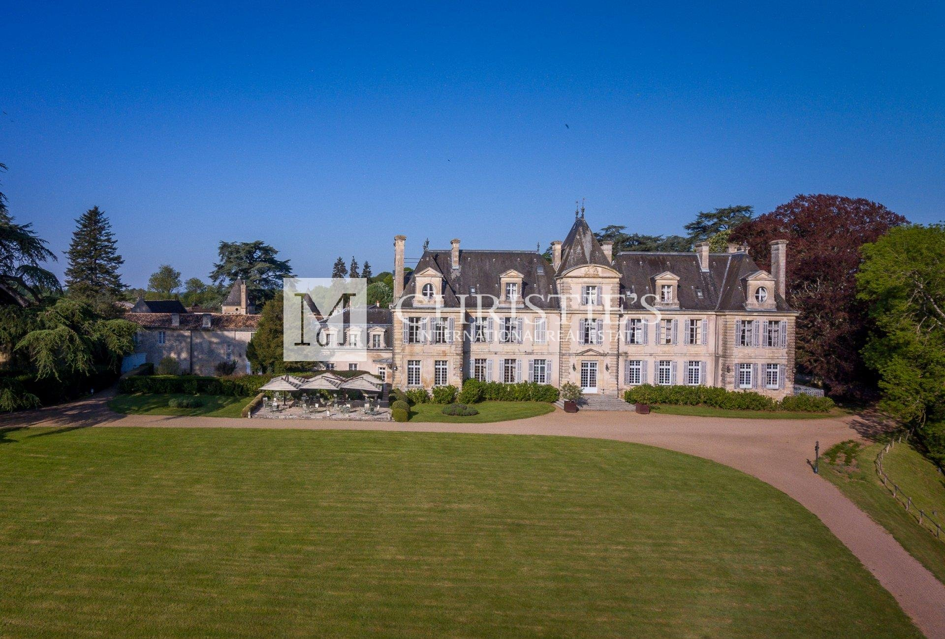 Large chateau with grass lawn