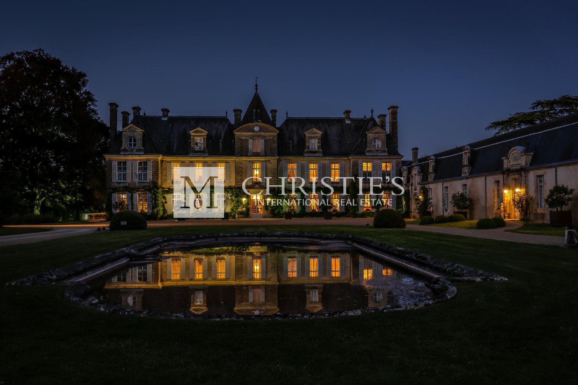 Large chateau with fountain in driveway