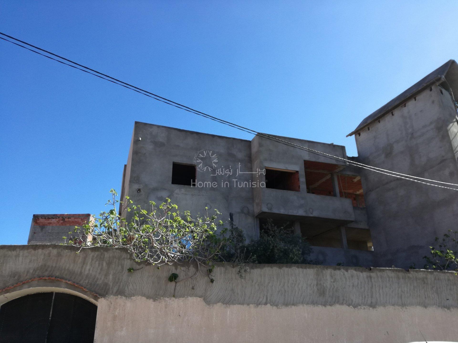 ensemble de 3 maisons